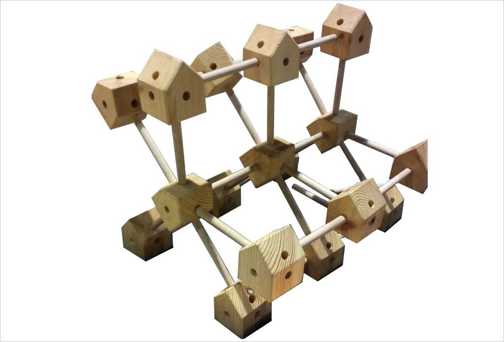 Jeu de construction g ant en bois bo te carton trigonos start for Construction en bois details